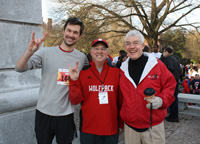 Krispy Kreme Challenge co-founder Greg Mulholland '07, Chancellor Randy Woodson, and Vice Chancellor for Student Affairs Tom Stafford.