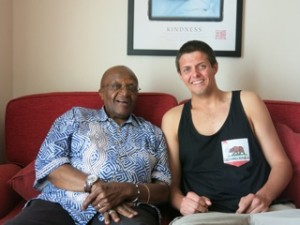 Wade Colburn with Archbishop Desmond Tutu during their time at sea.