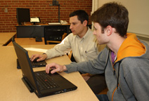 Dylan Cawthorne and Joe DeCarolis review energy systems data.