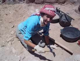 Caiti Cremer working at her team's excavation site in Petra.