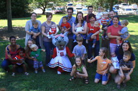Park alumni and their families with Ms. Wuf at the picnic held in Pullen Park.