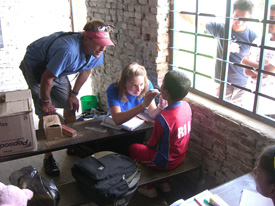 Anna Shope '08, who plans to specialize in pediatric dentistry, examines a young patient at an orphanage in Kathmandu, Nepal.