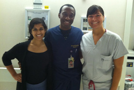 Catherine Thriveni '15 and Alyssa D'Addezio '14 with Dr. Jamandé Jones, a Pediatric Resident at the Brody School of Medicine