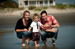 Brooke (Williams) Anderson '03 and Reeves Anderson '03 with their son Cord - Photo © Erin Sage Photography