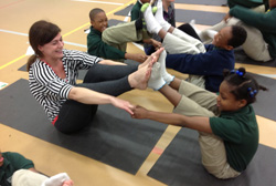 Jessica Hooks '03 participates in a YogaPowerPlay-led class with students at New Orleans' Crocker Elementary School in February 2014.