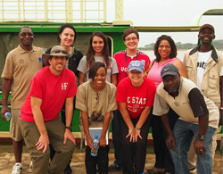 Derek Aday (front left), James Kiwanuka-Tondo (back left), and Park Scholars Maggie Miller '16 (back, third from right) and Tori Huffman '15 (front, second from right) on a trip to Uganda