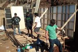 "Carter Ellis '15 helping to reconstruct a friend's home after ""The Great Fire of Valparaíso"" – April 2014"