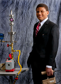 Carl Smith with the nuclear fusor he created in his garage for a high school project.