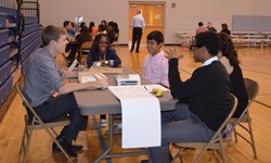 Billy Askey '05 shares advice with aspiring designers during Career Night at the Emily K Center in Durham, N.C.
