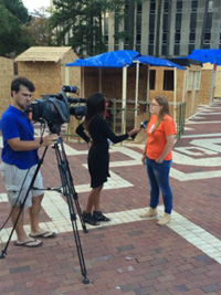 Sarah Paluskiewicz '16 being interviewed by Time Warner News about Shackathon - Fall 2014