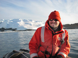 Miles gathering data in the team's Zodiac craft off the northern coast of Antarctica.