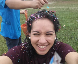 Jezzette Rivera '10 celebrating a south Texas Easter tradition wherein participants crack confetti-filled egg shells upon one another's heads.