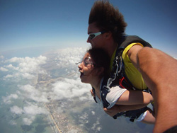 Jezzette Rivera '10 skydiving in South Padre Island, Texas to commemorate the end of her second year of teaching.
