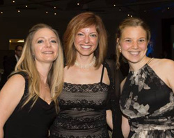 Leslie Scheunemann '01 (center) with friends and colleagues Shannon Haliko and Natalie Ernecoff at the 2014 Critical Care Medicine 50th Anniversary Gala