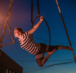 Maggie Miller '16 performs an aerial routine high over Raleigh's Warehouse District - Photo © Yorgason Photography