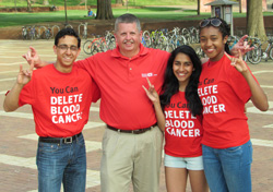 Rizwan Dard '17, DKMS' Bob Murray, Sammi Fernandes '17, and Adrienne Williams '17 during a bone marrow donor registration drive in the Brickyard – Spring 2015