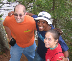 """Richard """"Memie"""" Ezike '05 (center) hiked with Adam Rush '05 and Hannah (Lippard) Caster '05 during their Park class' senior retreat to White Mountain National Forest in New Hampshire – Fall 2004"""