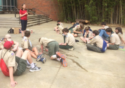 Alex Loflin '17 leading Boy Scouts in an activity to earn their Environmental Science Badge at a Merit Badge University event at NC State