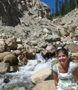 Kelly Mahoney '03 at Rocky Mountain National Park's Lawn Lake, site of a flood she studied which was caused by dam failure