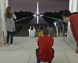Members of the Class of 2019 gaze at the Washington Monument from the steps of the Lincoln Memorial