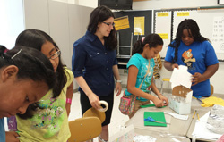 As an intern with Cabarrus County Schools, Ashley Lawson '18 (center) assisted with summer STEM and reading camps. Here, she worked with students in the Summer Bridge program to construct model shipping container homes. – Summer 2015