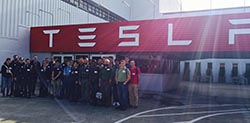 Liv Adams '16 (rear center) and her fellow interns during her co-op with Tesla Motors - Spring 2015