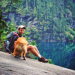 Elliott Welton '12 enjoying the great outdoors with his dog, Oscar