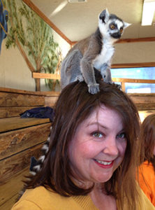 Patricia Crane '02, befriended by a lemur
