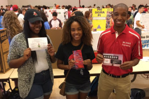 Felton volunteering with the National Society of Black Engineers
