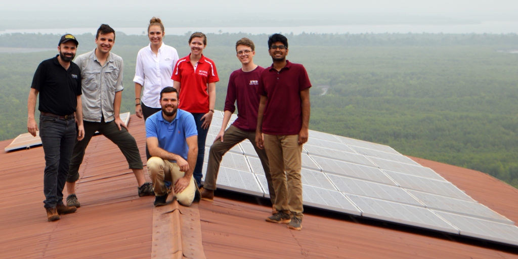 Evan Grant installing solar array as part of an NC State Engineers Without Borders project in Freetown, Sierra Leone