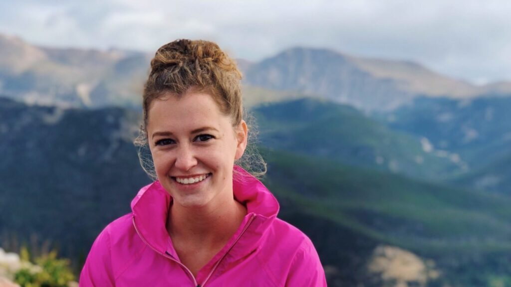 Abby Scheper in front of the Rocky Mountains