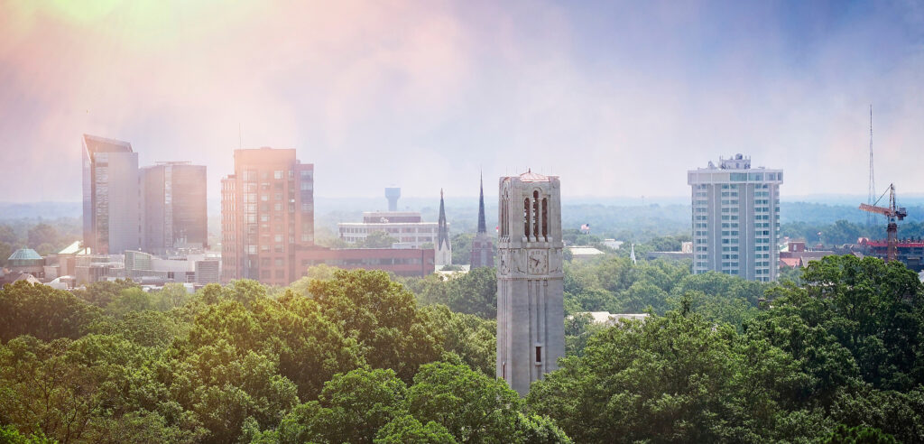 NC State Belltower and Raleigh skyline